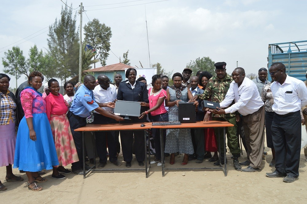 Midrift Hurinet donating Computers at Elementaita Police Station